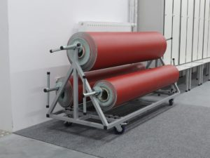 Storage trolley for 3 rolls of floor protection covering
